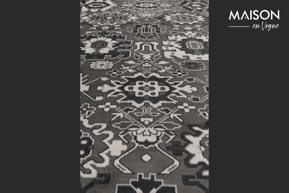 Descubrirá un conjunto de patrones modernos y sofisticados en esta alfombra tejida con acabados