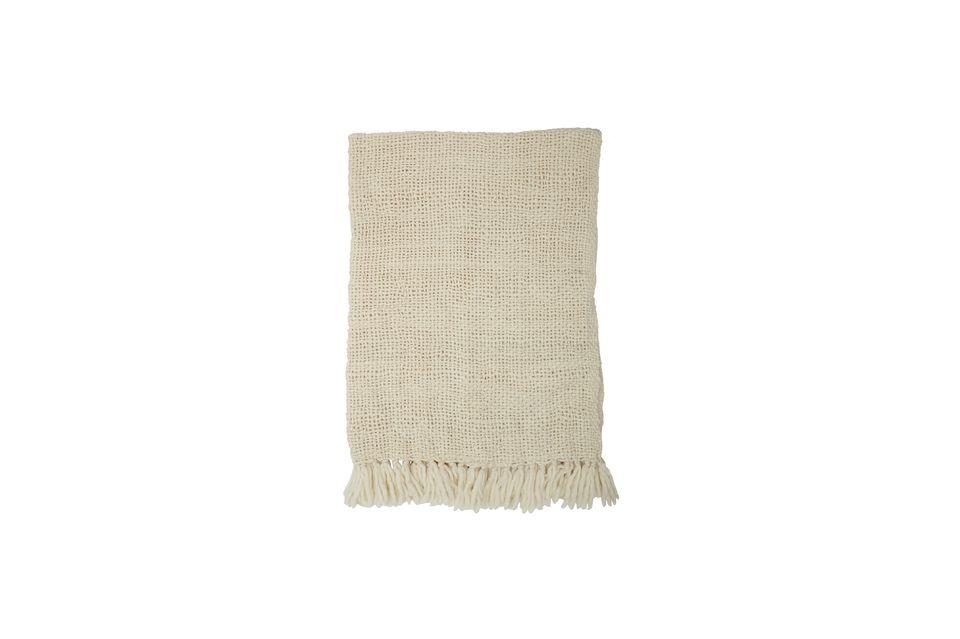 Su material suave y cálido, tejido con un espíritu muy gráfico, atrae por su flexibilidad