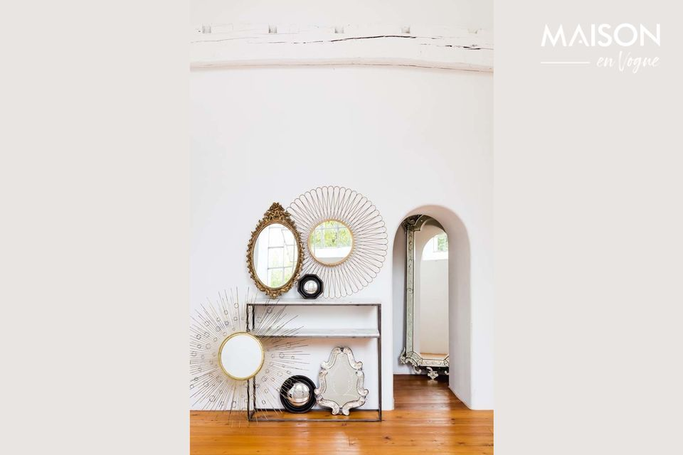 Una consola de estilo art decó con dos estantes de mármol y metal