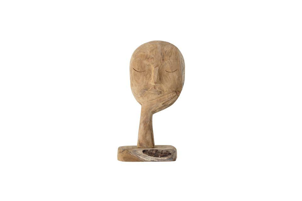 Esta escultura en forma de rostro inmerso en sus pensamientos es todo menos tradicional