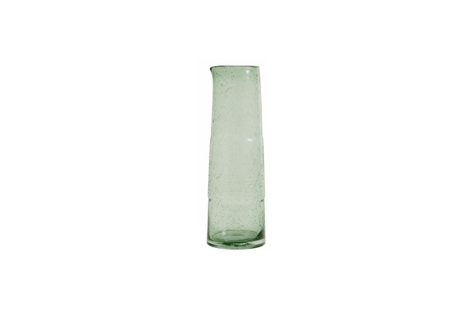 La sobriedad de las líneas combinadas con el uso de vidrio reciclado hacen que sea un servicio