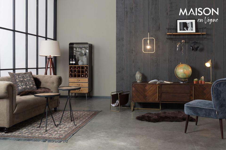Una lámpara suspendida con altura ajustable, con un diseño industrial puro