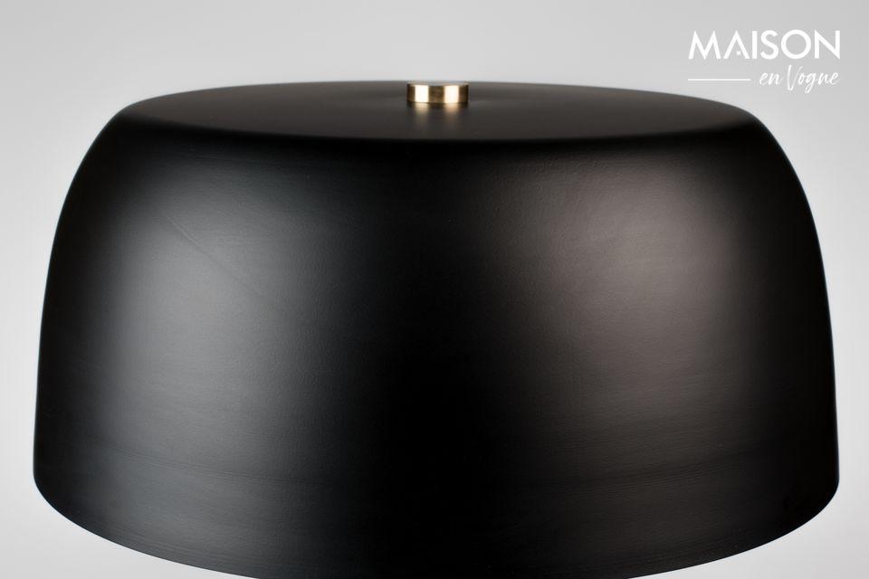 Esta lámpara de mesa Muras negra y tricolor gris revela un diseño meticuloso con acabados suaves y