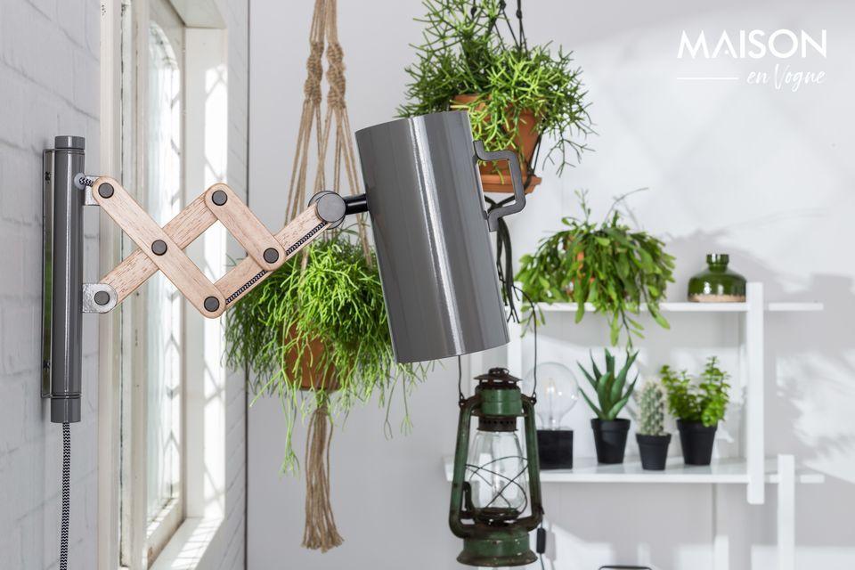 La elegante lámpara de pared gris Flex parece estar montada en un resorte con su brazo extensible