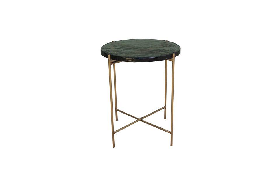La mesa auxiliar de Courlon también está hecha de cristal, pero no es frágil