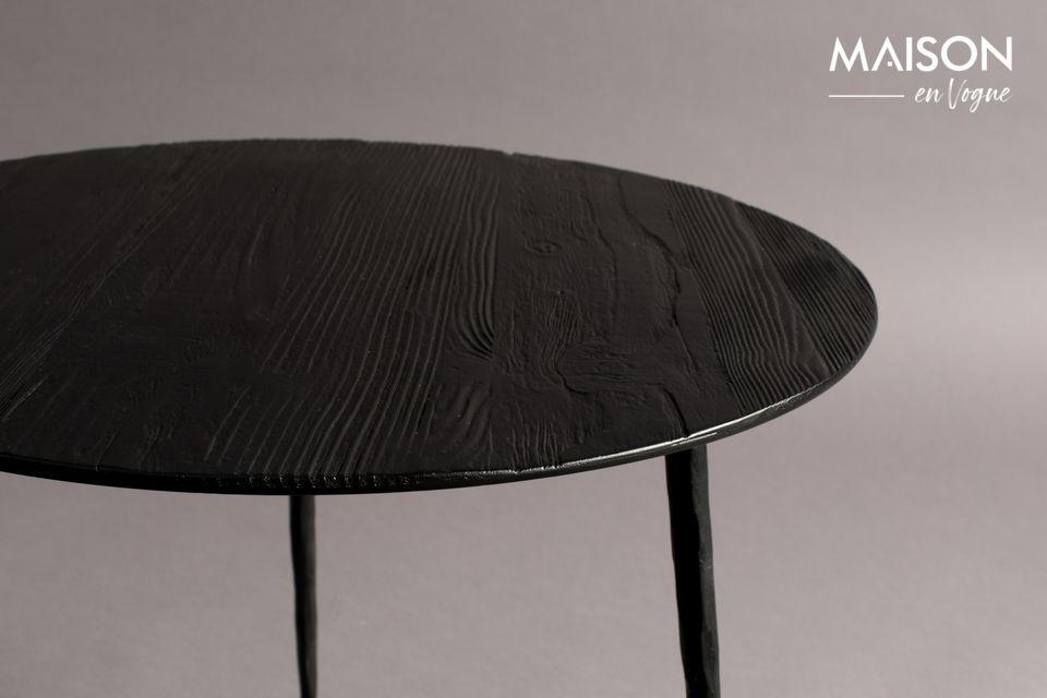 Su tapa circular de acero lacado tiene una fina chapa de pino o roble