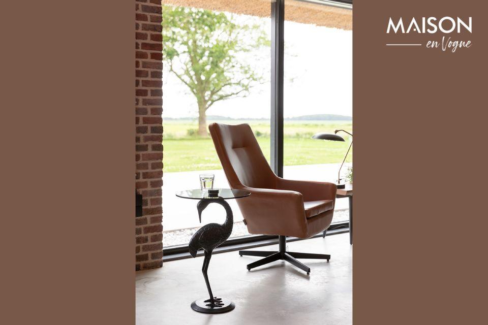 Mesa elegantemente diseñada con una grúa como pata de la mesa