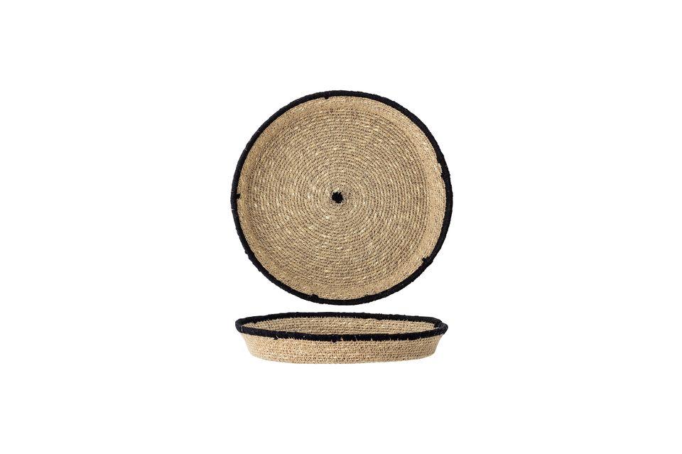 Su diseño circular está resaltado por un borde y centro negros