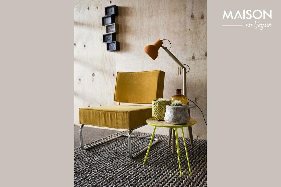 Una silla cómoda que combina estilos vintage e industriales