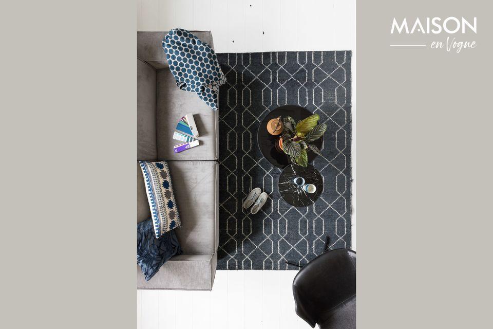 Un sofá de dos plazas en tela y estilo moderno